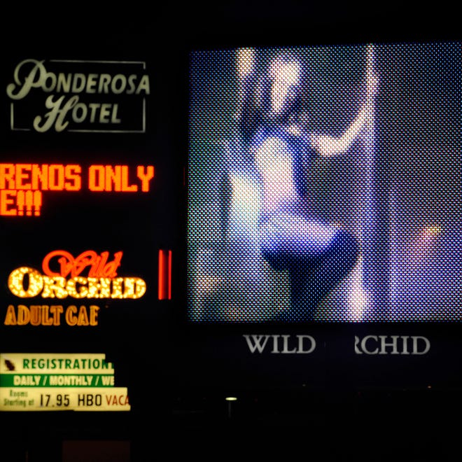 The video sign outside the Wild Orchid gentleman's club on Monday, May 2, 2011. Photo by David B. Parker.