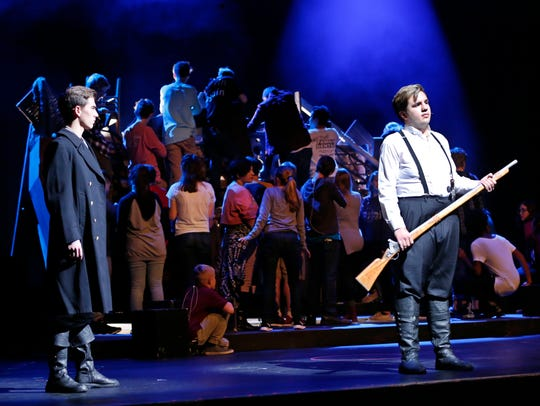 Christian Heitmiller, left, in the role of Javert and