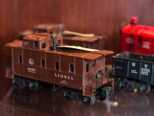 Model trains sit on a showcase inside Grandpa's Garage,