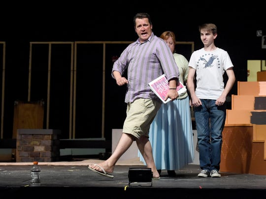 Director Hank Fitzgerald struts across the stage as he explains to the actors where and what he wants during a blocking session in rehearsals on July 6, 2015.