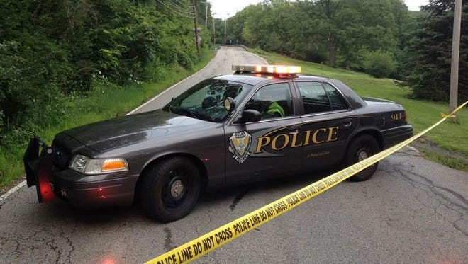 Delhi police block of Rapid Run in Delhi Township after finding a body near the road.