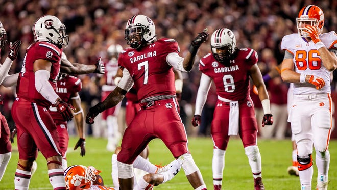 South Carolina defensive end Jadeveon Clowney (7) celebrates a tackle for loss.