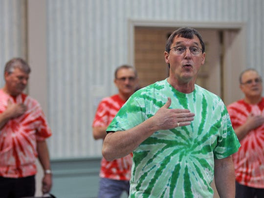 Co-director Doug Smeltz leads The Fun Center Chordsmen during practice at First Congressional Church.