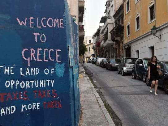 A  slogan on a wall in Athens  on  May 12 , 2017, complains