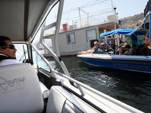 Roland Rojas, a senior member with the Tulare County Lake Patrol, checks on a boat at Lake Kaweah on Saturday.