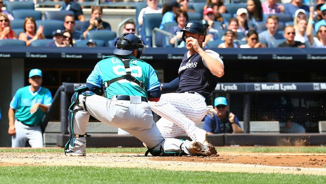 Greg Bird is tagged out at home plate while trying to score on Jacoby Ellsbury's RBI single in the second inning. Bird was activated from the disabled list before the game after being out since May 2.