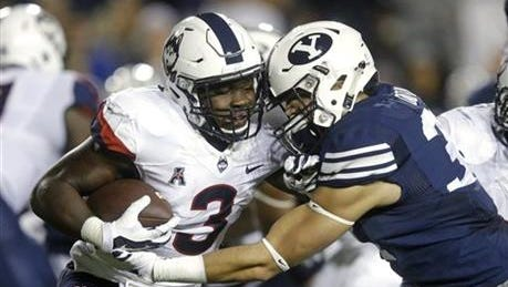 BYU linebacker Sae Tautu, right, tackles Connecticut running back Ron Johnson (3) in the first half during an NCAA college football game Friday, Oct. 2, 2015, in Provo, Utah.