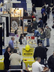 Visitors check out the vendor booths during the 2015
