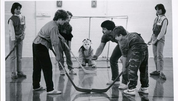 Tim Staley (holding the puck) aligns players for a
