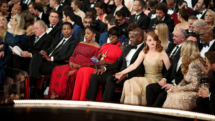 HOLLYWOOD, CA - FEBRUARY 26:  Actors Denzel Washington, Viola Davis, Julius Tennon and Emma Stone attend the 89th Annual Academy Awards at Hollywood & Highland Center on February 26, 2017 in Hollywood, California.  (Photo by Christopher Polk/Getty Images)