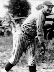 """Shoeless Joe"" Jackson is shown in action during his"