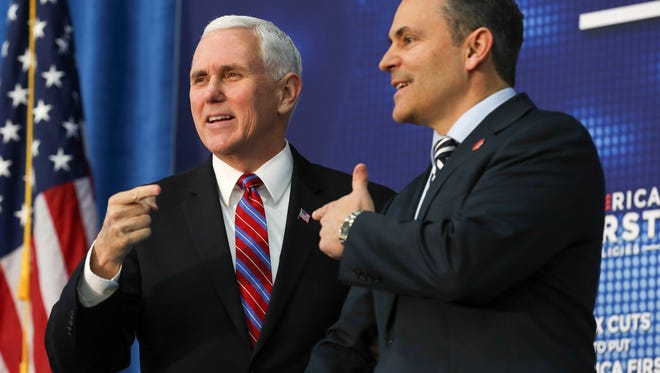 Vice-President Mike Pence is greeted on the stage by Kentucky Governor Matt Bevin before he spoke to a crowd at an America First event in Versailles, Kentucky, on Wednesday afternoon.  The vice-president touted the administration's accomplishments since taking office along with highlighting the effects of the recent tax cuts.March 7, 2018