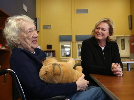 Mischelle Denison of Johnson visits with her mother-in-law,