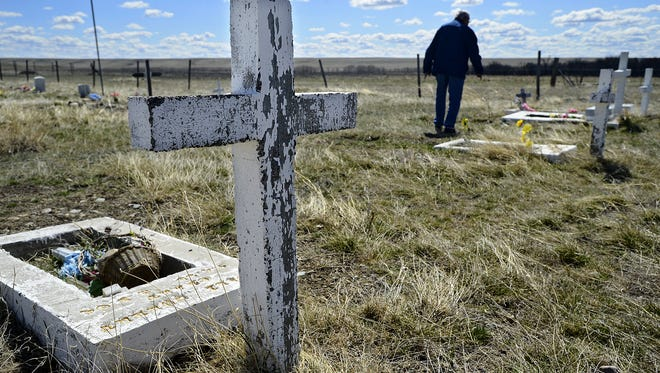 The Holy Family Mission Cemetery on Joe Show East Road near Browning where victims of the 1964 flood are buried.