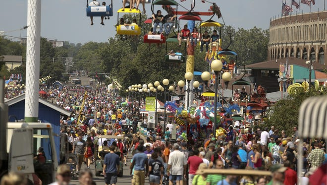 Fairgoers pass down the Grand Concourse at the Iowa State Fair.