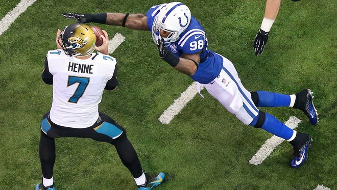 Jacksonville Jaguars quarterback Chad Henne is sacked by Indianapolis Colts Robert Mathis in the first half of Sundays game on December 29, 2013. The Colts beat the Jaguars 30-10.