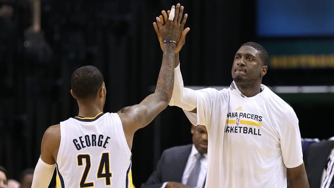 Indiana Pacers Roy Hibbert,right, high-fives Paul George in the fourth quarter of their game. The Indiana Pacers defeated the Sacramento Kings 116-92 Tuesday, January 14, 2014, evening at Bankers Life Fieldhouse.