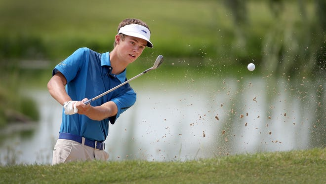 Carmel's Kevin Stone chips onto the 8th green at the Zionsville Golf Sectional at Golf Club of Indiana in Lebanon, Ind.