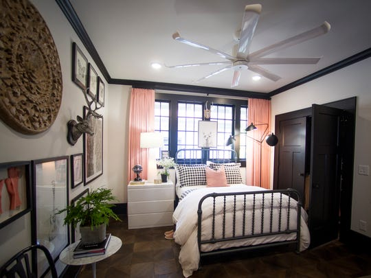 A bedroom in HGTV's Urban Oasis 2017 in the 4th & Gill