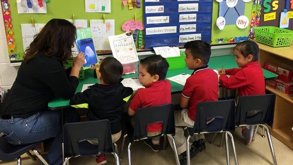 Myrtle Cooper Elementary School prekindergarten students practice their letters.