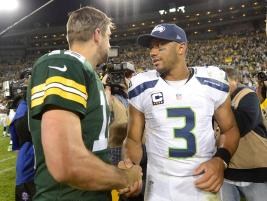 Aaron Rodgers, Russell Wilson