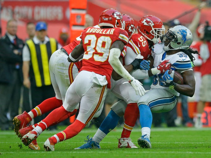 A host of Chiefs tackle Lions running back Joique Bell