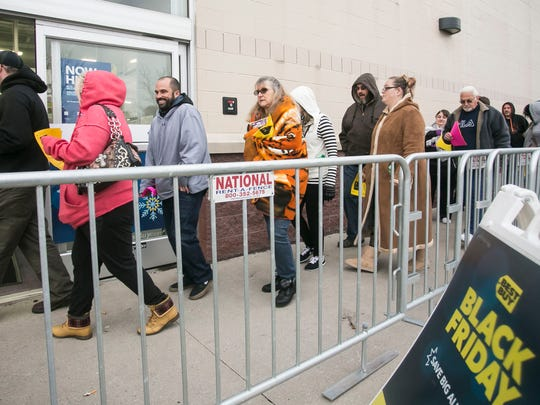 Black Friday shoppers walk into the Springettsbury Township Best Buy location. Amanda J. Cain photo