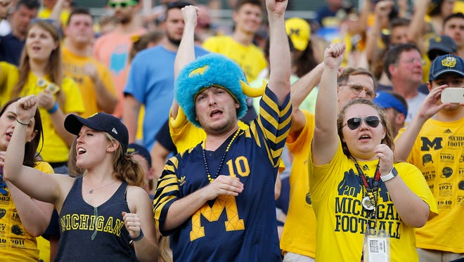 Michigan Wolverines fans cheer in the 2016 Citrus Bowl against the Florida Gators.