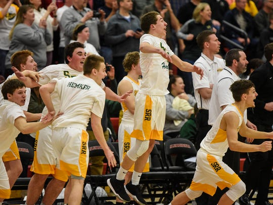 Sauk Rapids players react on the bench in the final