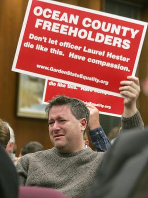 Steven Goldstein, then-chairman of Garden State Equality, fights back tears at a meeting of the Ocean County Board of Freeholders on Dec. 7, 2005.