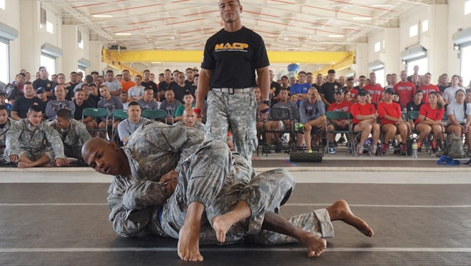 Sgt. Christopher Thomas gains position against his opponent during The Adjutant General's Cup combatives event at the Guard Readiness Center on Saturday, July 11, 2015. Thomas helped the Army earn a shutout victory.
