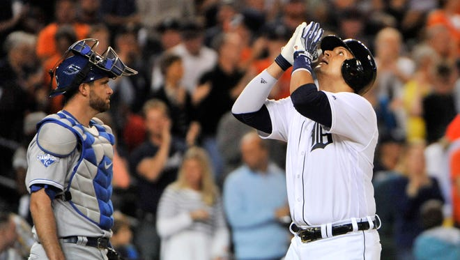 Tigers designated hitter Victor Martinez points upward after his solo home to add to the Tigers lead, making it 3-0 in the third inning Friday night. Martinez went 2-for-2 with two RBIs and two walks.