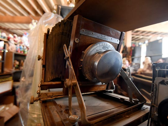 An antique view camera is one of the many treasures at City Mills.