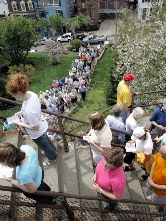Catholic faithful stop and pray on each of the 85 steps leading up to Holy Cross Immaculata Church, Friday, April 14, 2006, in Cincinnati. An estimated 10,000 people take part in the annual Good Friday tradition that dates back to 1861. (AP Photo/Al Behrman)