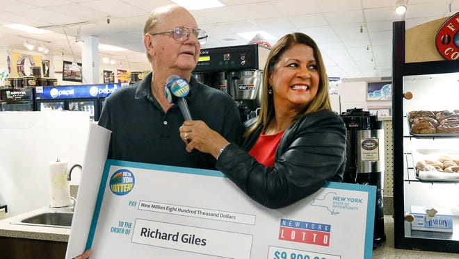 Richard Giles, 76, of Macedon won the flagship Lotto game on Oct. 11, 2017 after purchasing several tickets with a winning price of $9.8 million at Hegedorns Market in Webster. He will receive $4,419,643 after the required withholdings. The ceremony  at the store took place with lottery spokeswoman Yolanda Vega seen here with him.