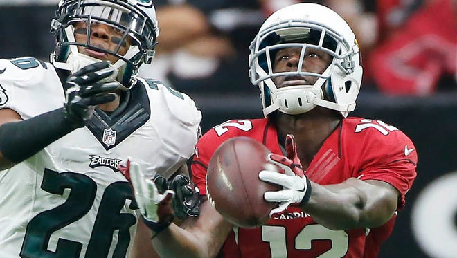 Arizona Cardinals WR John Brown catches a pass ahead of Philadelphia Eagles CB Cary Williams during the second quarter of NFL action at University of Phoenix Stadium in Glendale, Ariz. October 26, 2014.