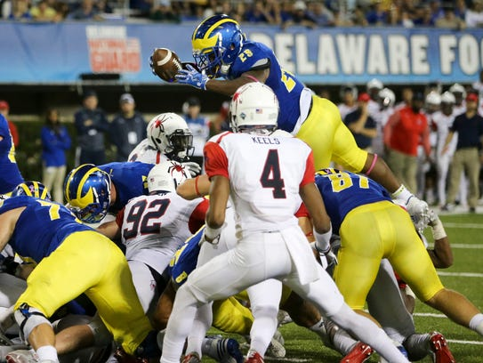 Delaware running back Kani Kane plunges into the end
