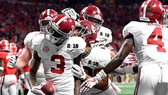 Jan 8, 2018; Atlanta, GA, USA; Alabama Crimson Tide wide receiver Calvin Ridley (3) celebrates scoring a touchdown during the fourth quarter against the Georgia Bulldogs in the 2018 CFP national championship college football game at Mercedes-Benz Stadium. Mandatory Credit: John David Mercer-USA TODAY Sports