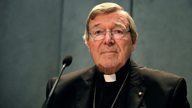 Australian Cardinal George Pell looks on as he makes a statement at the Holy See Press Office, Vatican City on June 29, 2017 after being charged with historical sex offences in a case that has rocked the church.