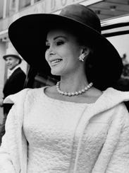 Actress Zsa Zsa Gabor, shaded by a black organza hat,
