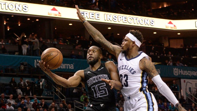 Charlotte Hornets guard Kemba Walker (15) drives to the basket and scores against Memphis Grizzlies Ben McLemore (23) during the second half at the Spectrum Center. The Hornets won 140-79. That score is not a typo.