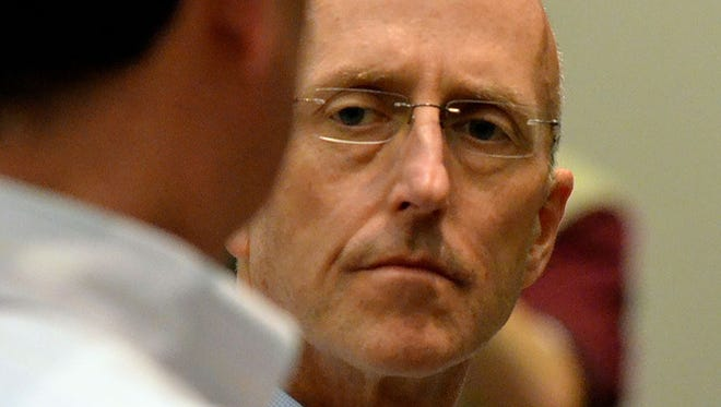 Attorney Mark Mayfield listens to his attorney John Reeves during his initial apperance in court in Madison Thursday.