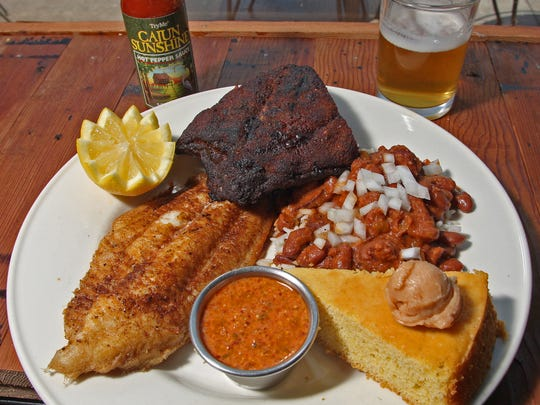 Red Neck Surf-n-Turf: Cajun Catfish & Ribs, red beans & rice, served at Flying Mango, 4345 Hickman Rd., on Tuesday, June 28th, 2011. Photo by BILL NEIBERGALL DES MOINES REGISTER, DES MOINES JUNE 28TH, 2011