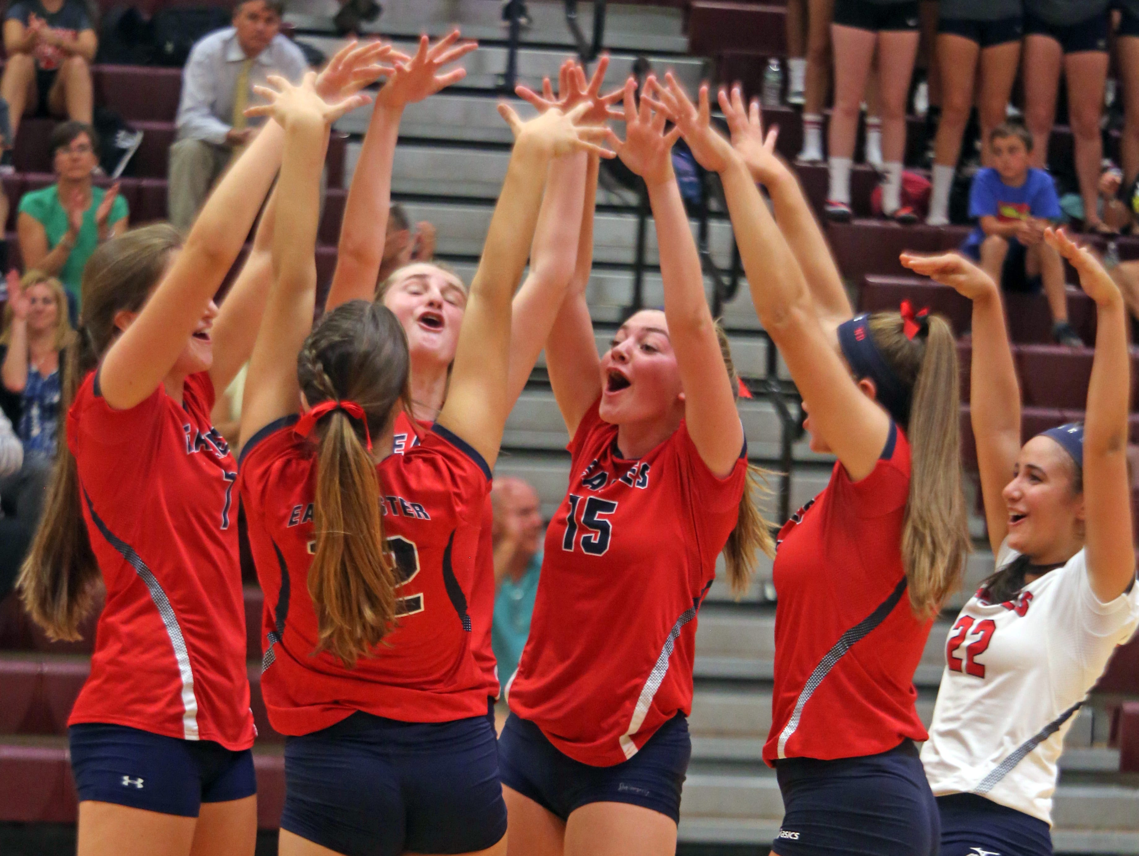 Eastchester celebrates after scoring a point against Harrison during a volleyball match at Harrison High School on Thursday.