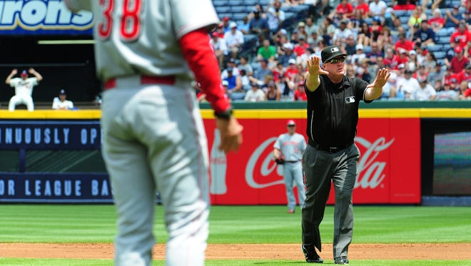 Reds manager Bryan Price disputes a call with umpire Bill Miller during the first inning against the Atlanta Braves at Turner Field on April 27, 2014 in Atlanta, Georgia.