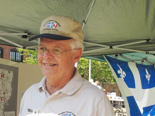 Jon Fisher of Burlington discusses his geneological work Saturday at French Heritage Day in Winooski.
