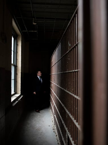 Freeholder Bill Moen explores an old jail housed on the sixth floor City Hall Friday, Jan. 12, 2018 in Camden, N.J. The jail has been out of commission since 1988 and is currently being demolished.