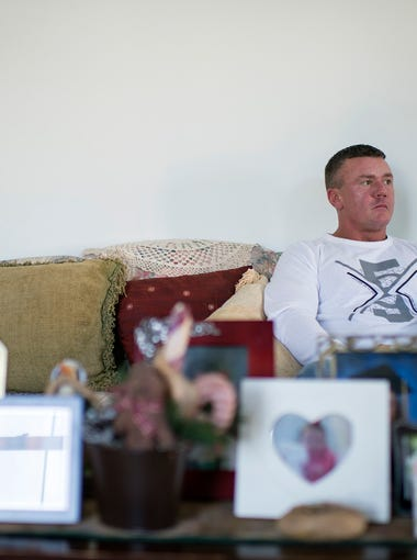 Chris Cisco in his home Thursday, Jan. 25, 2018 in Sewell, N.J. Cisco, who is now three years clean, went through an opioid addiction for many years.