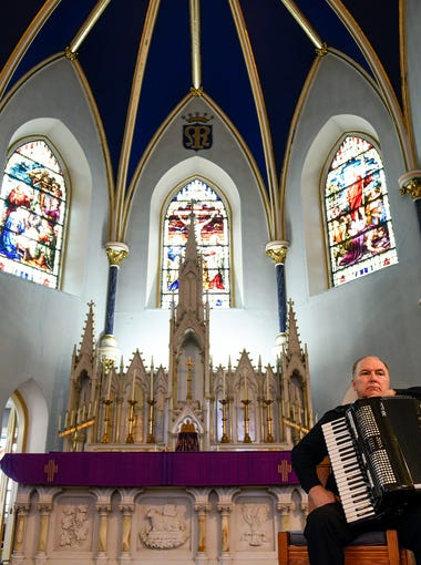 Monsignor William Hodge sits with his accordion after playing inside St. Mary's Church Friday, Feb. 23, 2018 in Gloucester City, N.J. Hodge is of Irish decent and has recorded multiple albums relating to his heritage and Catholicism.