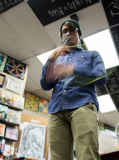 Yoyoer Tyler Severance, 26, practices inside Tiki Tiki Board Games Tuesday, March 27, 2018 in Woodbury, N.J. Severance, a world champion at the age of 16 and three-time national champion, launched his own yo yo company Recess in 2015.